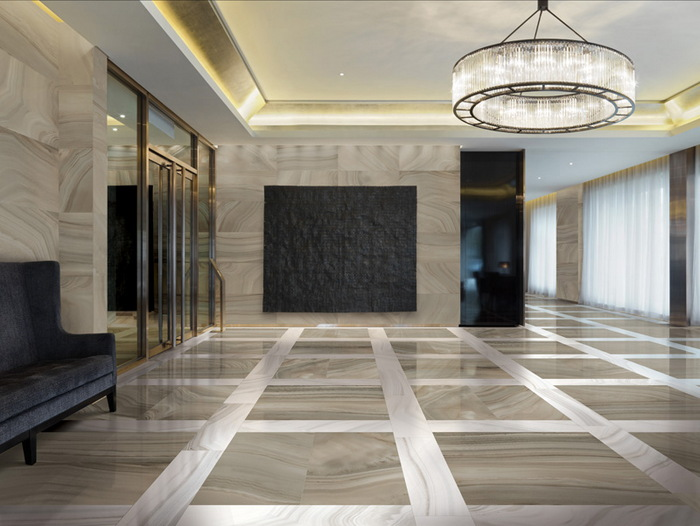 Modern lobby with large chandelier and marble floors